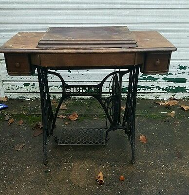 Antique vintage Singer Sewing machine and base table cast iron,
