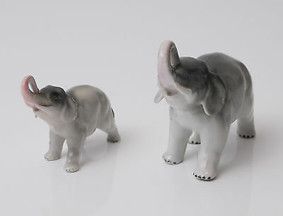 Two Sitzendorf Elephant Figures with Raised Trunks and Grey Glaze