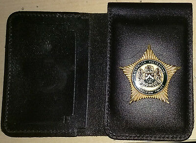 Obsolete Transkei police wallet with badge