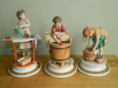 Three Italian Capodimonte pottery figurines of washer girls by Sandro Maggioni