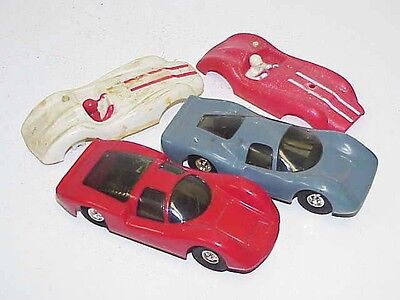 Two 1960's Slot Cars & 2 plastic car bodies