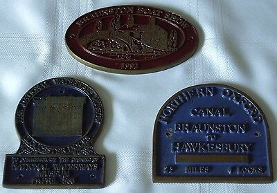 3 brass canal plaques