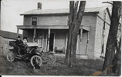 Real Photo Postcard Couple and dog at Residence with vintage auto Plate #576685