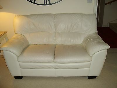 Pair of two seater cream leather sofas