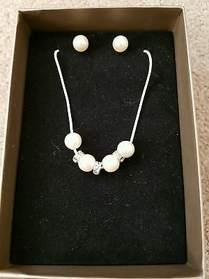 Faux pearl and diamante necklace and earrings set