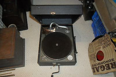 A  good working Brunswick portable gramophone phonograph C/W needles & records