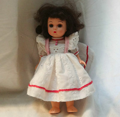 "Madame Alexander 8"" plastic doll Brunette in white dress with pink trim"