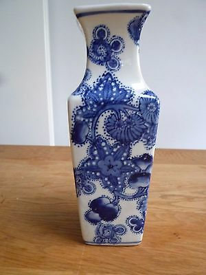 Vintage hand-painted blue and white pottery vase