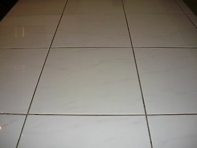High gloss white tiles with grey marbling