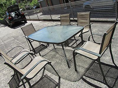 Glass top outdoor table and six chairs