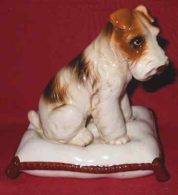 China Dog Figure, Airdale Terrier Sitting on a Cushion, Unmarked