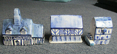 Three miniature pottery blue and white houses, most likely Gibson largest 4 inch