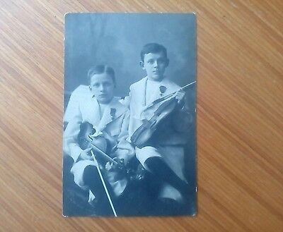 Vintage* Two boys with Violins and Bows. Imprinted : C Schulz Riga ( Latvia ).