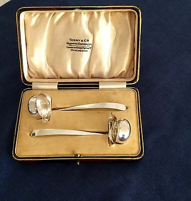 A Pair Of Antique Sterling Silver Cream Ladles.
