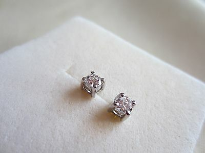 9ct White Gold Stud Earrings with claw held CZ.