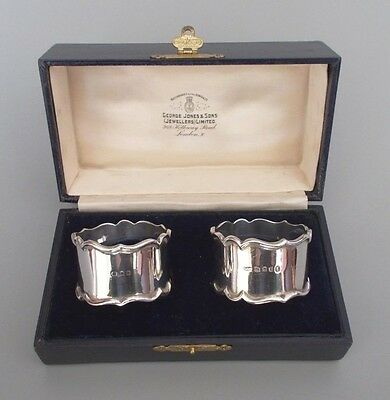 Boxed pair solid silver napkin rings, Josiah Williams & Co., London 1932/34