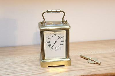 A Small Antique Brass Cased Carriage Clock Bevelled Glass In Good Working Order