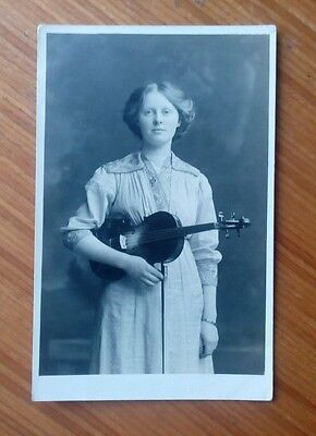Vintage* Lady with a violin and bow.  Could be Edwardian.