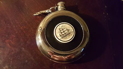 round flask sailboat design vintage
