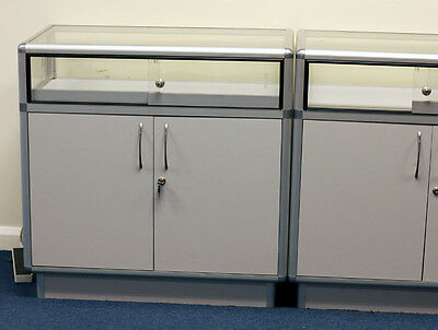 2x used showroom cabinets, with glass top.