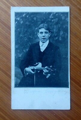"""Vintage* Young lad with a violin and bow. Written in pencil """" Watford Company """"."""