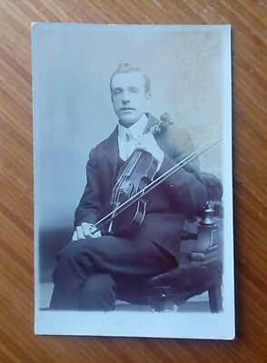 Vintage* Seated gentleman with a violin and bow.  Real Photo.  Early 1900's.