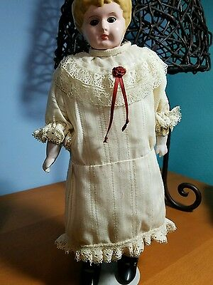 Antique Tin Head Doll/ Germany / Kid leather body/ sawdust stuffing