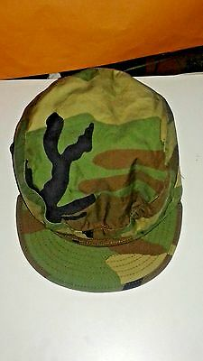camouflage cap official with pull out ear warmers adult size 7.5