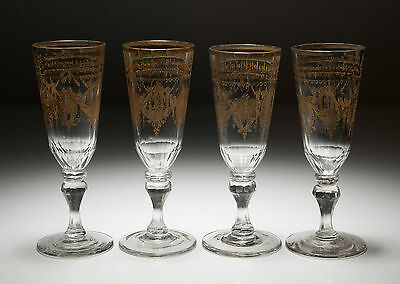 A Set of Four Antique Georgian Bohemian/German Gilded Champagne Glasses