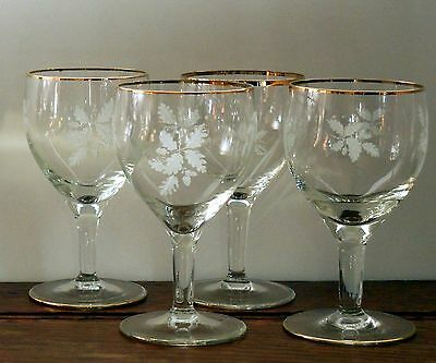 A set of 4 fine Sherry / port glasses with gilt rim  and printed oak leaf acorn