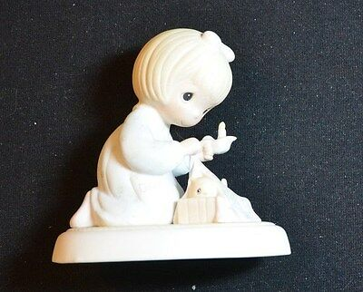 "1983 Precious Moments figure ""Dawn's Early Light"""