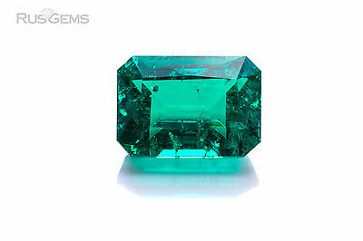 Created Emerald 8.59 ct. Emerald shape 14x10 with inclusions.