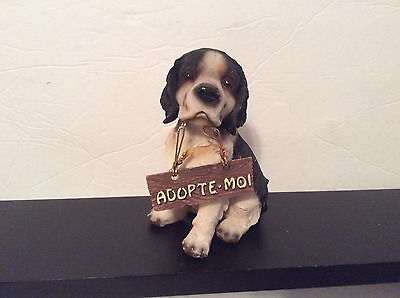"Resin Dog Figurine, Black and White, Sitting, with sign ""Adopte-Moi"", 5"""