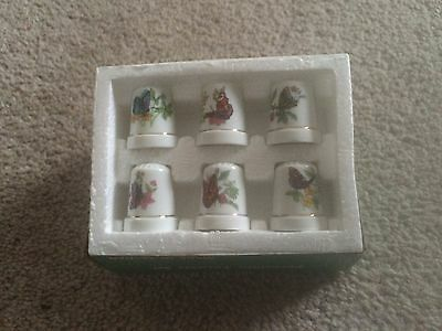 "Set of 6 Porcelain Butterfly Thimbles with ""Gold"" Trim"