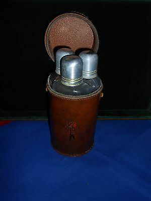 Bivintage leather case ncludes three glass bottles