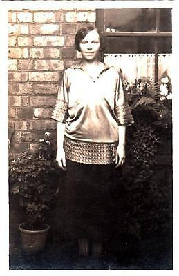 R38.Vintage Postcard. Unknown Woman in front of her house. Blouse.
