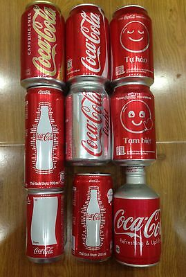 9 cans Coca Cola , open top , Vietnam , Japan and USA