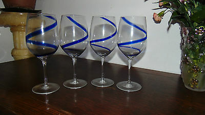 four hand made large matching wine glasses