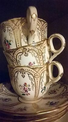 Antique unmarked ornate handpainted tea cup and saucer set