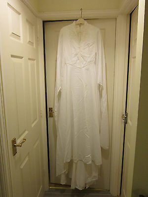 White vintage 1970s wedding dress scull cap and veil