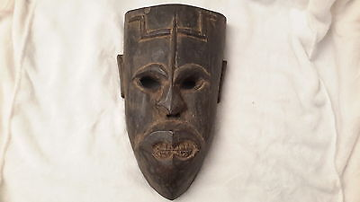 Carved wooden mask. Asian.