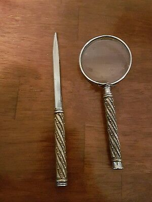 antique magnifying glass and letter opener