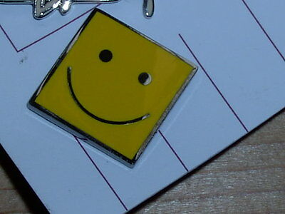small square smiley face pin badge