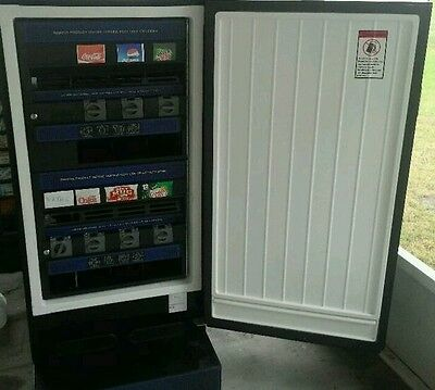 Antares Refrigerated Soda On 1 Side And Snack Vending Machine On The Other Works