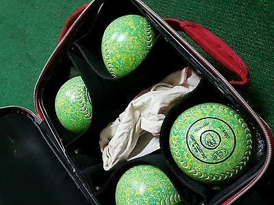 Lawn bowls. Size 2, taylor. Green with yellow & orange fleck + bag