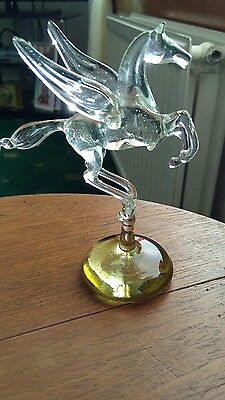 Clear glass Pegasus horse on green base