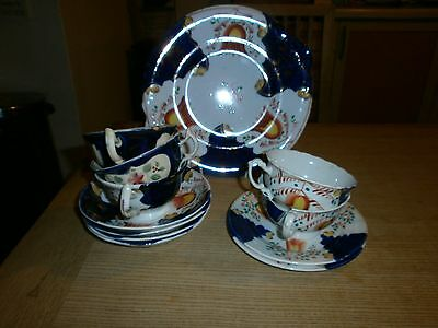collection of gaudy welsh plates and cups and saucers