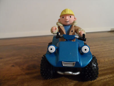 Bob the builder figure and buggy.