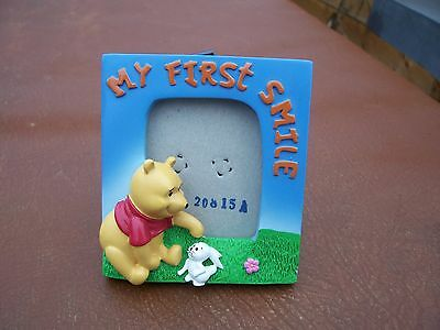 From Disney Small Ceramic Winnie The Pooh My First Smile Photograph Frame