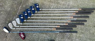set of Taylor made golf clubs and Taylor golf bag